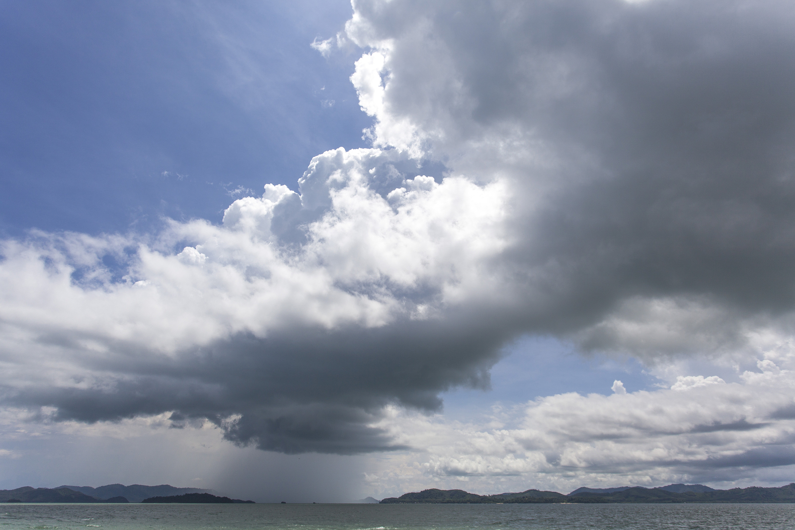rain clouds and rain on Phuket island in Thailand.